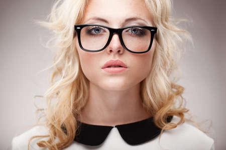freckles: closeup horizontal portrait of blonde young beautifulwoman wearing eyeglasses Stock Photo