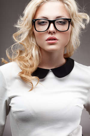 portrait of blonde young beautiful woman wearing eyeglasses Stock Photo