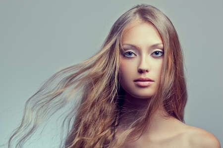 beautiful woman face portrait with flying hair