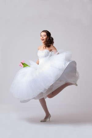 beautiful bride jumping in studio