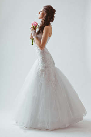 beautiful bride studio full length portrait with backlight