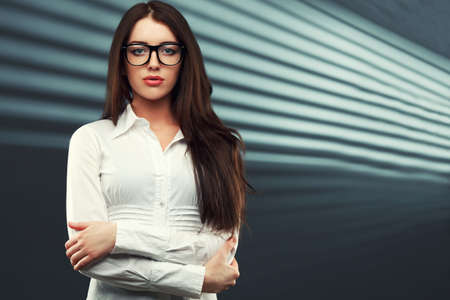 businesswoman wearing glasses in front of a striped background photo