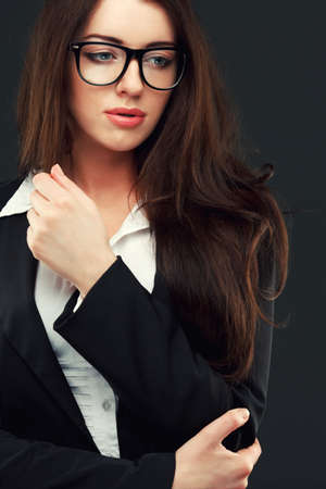sexy teacher: close-up portraits of a business woman on a dark background