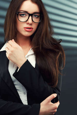 sexy teacher: close-up portraits of a business woman on a dark striped background