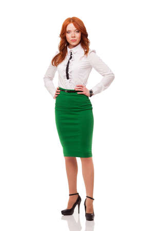 businesswoman wearing green skirt , full length isolated over white photo