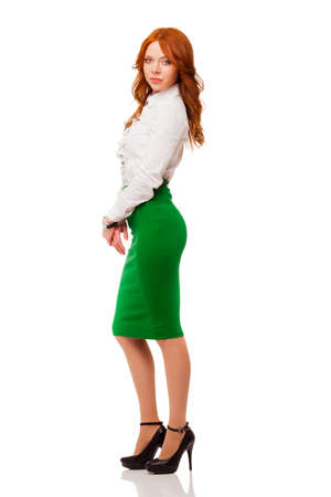 red haired: businesswoman wearing green skirt , full length isolated over white Stock Photo