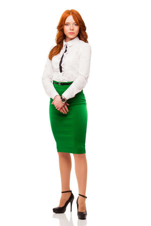 skirt: businesswoman wearing green skirt , full length isolated over white Stock Photo