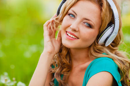 close-up outdoors smiling portraits woman in headphones photo