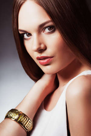 closeup woman portrait  wearing bracelet on hand photo