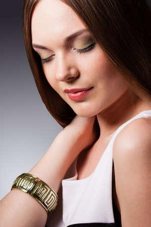 closeup woman portrait with closed eyes wearing bracelet photo