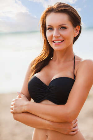 beautiful sexy brunette woman wearing bikini closeup outdoors portrait
