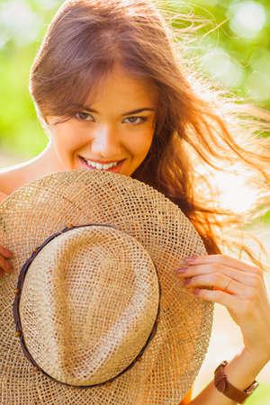 sundress: happy girl closeup portrait with straw green summer park