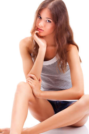 beautiful smiling girl wearing jeans shorts sitting on the floor, closeup portrait photo