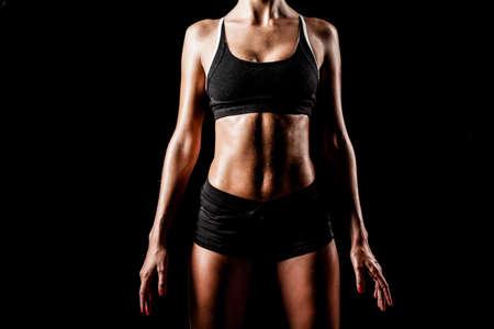 model nice: sport woman body wearing black sportswear