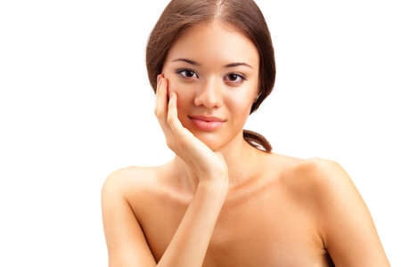 touching face: closeup beautiful woman portrait over white
