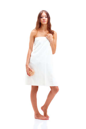 full length woman portrait  wrapped in bath towel over white photo