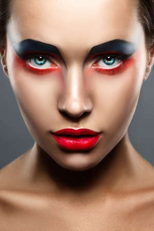 make up eyes: closeup beauty creative red and blue makeup woman face
