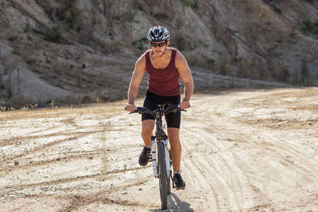 athlete man cycling on a bicycle ounddors in stone pit