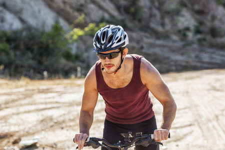 velo: athlete man cycling on a bicycle ounddors in stone pit