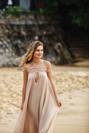 appealing attractive: beautiful blonde girl walking on sand fashion outdoors portrait