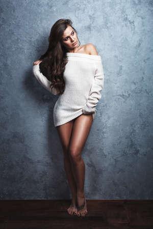 Sensual portrait of sexy brunette woman in sweater