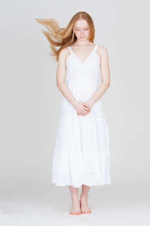 flying hair: woman with flying hair wearing white dress