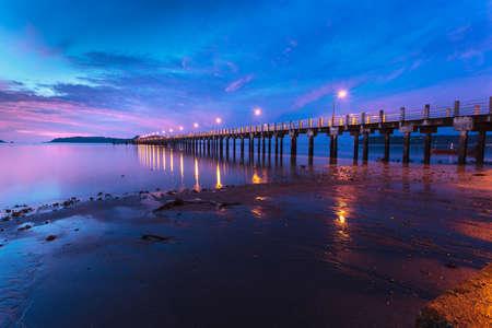 beautiful sunrise at the sea pier during tide photo