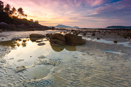 beautiful sunrise at the tropical andaman sea during tide photo