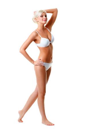 slender: blonde woman wearing white underwear isolated over white