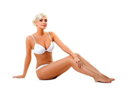 blonde woman wearing white underwear sitting on the floor