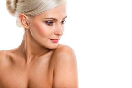 Head and shoulders of a gorgeous blonde nude woman isolated photo