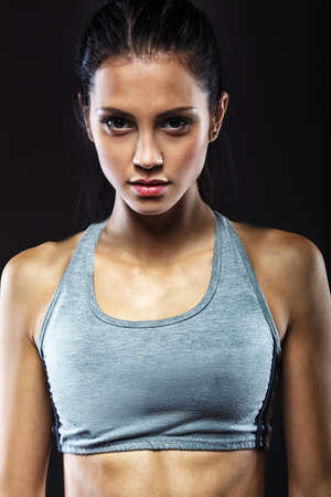 seriously: closeup portrait of sporty beautiful brunette woman
