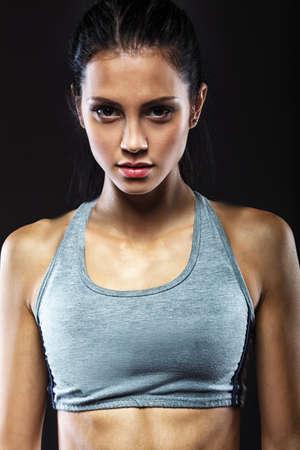 sporty: closeup portrait of sporty beautiful brunette woman