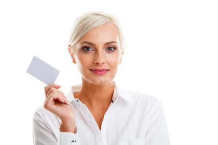 Happy blond woman showing blank credit card over white background photo