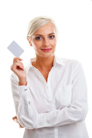 Happy blond woman showing blank credit card over white  photo