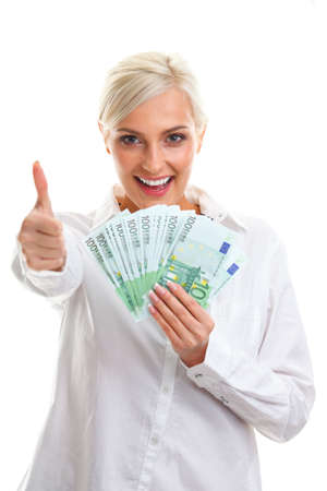 woman holding money: happy young woman holding euro bills over white