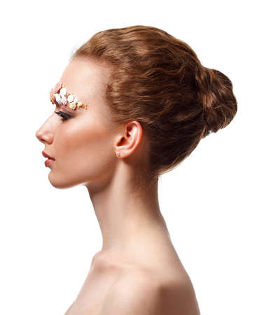 skintone: Beauty model portrait with creative makeup,  eyebrows from flowers, profile view