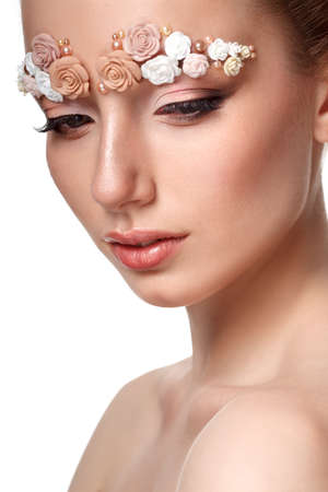 skintone: Beauty model portrait with creative makeup,  eyebrows from flowers, looking down