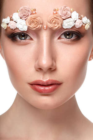 skintone: Beauty model headshot portrait with creative makeup,  eyebrows from flowers