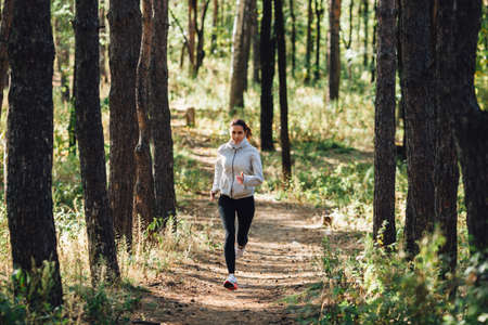 jogging in park: runner caucasian woman jogging in autumn park Stock Photo