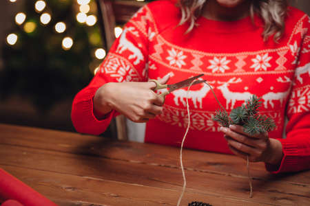 twine: woman hands cutting jute twine, rustic christmas style Stock Photo