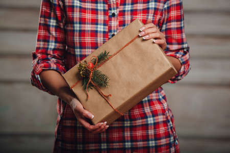 hand crafted: Hand crafted gift box in woman hands, rustic style