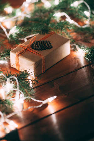 fur tree: gift box and fur tree on wooden background, rustic syle, film effects