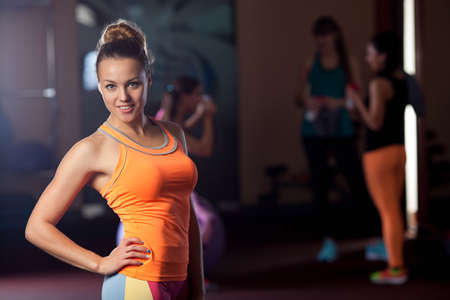 young adult woman: young adult sporty woman posing in the gym
