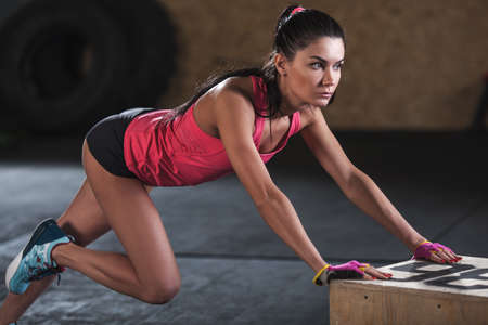 woman doing workout in  the gym, climber exercise closeup