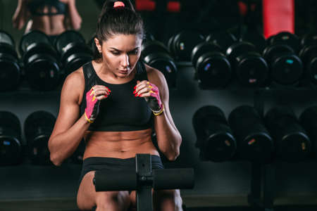 workout gym: fitness brunette woman doing abdominal crunch in gym woking out Stock Photo