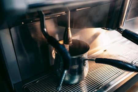 steam machine: Blast of steam on coffee machine, boiling water