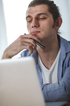 homeoffice: portrait of working man at his home