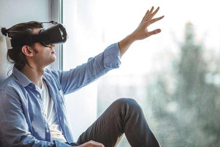 Surprised man using VR headset
