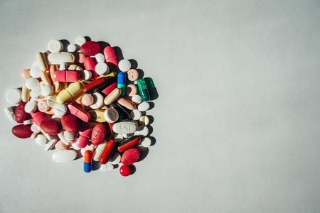 Colorful pills isloated on white table Stock Photo